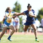 Otago player Alena Saili fends off a Bay of Plenty defender during the national sevens tournament...