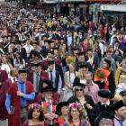 The latest University of Otago academic procession surges along George St, Dunedin, towards the...
