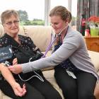 Bev Collis receives a check-up from Home Team registered nurse Michelle Fleury in her Brockville...