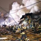 Firefighters operate at the site where a large explosion occurred at a restaurant in Sapporo....