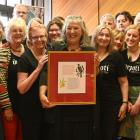 Dunedin Public Libraries citation winner Moana Wesley (holding the citation) with the waiata...