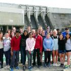 Taking a tour of the Clyde Dam are New Delhi students (front, from left, red top) Allen Alex (17)...