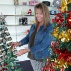 Tapanui Chemist duty manager Tracy Jane adjusts one of the charitable entries in the TWO...