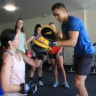 Two-time Commonwealth Games boxing gold medallist David Nyika shows St Kevin's College year 10...