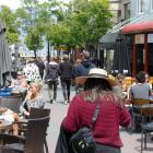 Diners enjoy the atmosphere in Mall St in Queenstown yesterday. Photo: Joshua Walton