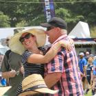 Timaru's Leanne Ryan gets a hug from her husband, Greg, after their horses finish one and two in...