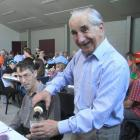 Michael Cresswell, of Oamaru, makes sure everyone at his table has a drink before the start of...
