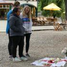 Mourners pay their respects to Grace Millane at a memorial in her honour at Queenstown's...