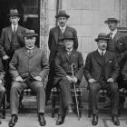 New Zealand press delegates touring Europe with politicians in London. Front row: Hon W.J. Geddes...