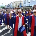 Graduands march down George St in Dunedin before two graduation ceremonies at the Town Hall on December 14, 2018. Photo: Craig Baxter