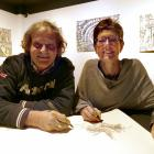 Luigi and Kate Agnelli work on their art in the exhibition space at Lakes District Museum. Photo:...