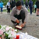 Josh Lewis, a close family friend of Grace Millane's, lights a birthday cake in her honour at...