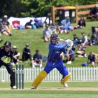 Michael Rippon plays a cut when batting against Wellington at the University of Otago Oval on...
