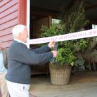 Hurunui Mayor Winton Dalley cuts the ribbon to officially open the restored woolshed. Photo: Gary...