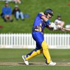 Otago Volts batsman Hamish Rutherford smacks a four runs Otago's match against Canterbury at the...