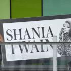 Contractors carry a large sign into Forsyth Barr Stadium for tonight's Shania Twain concert....