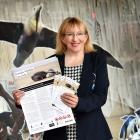 Dunedin Host Sustainability Group chairwoman Sophie Barker shows off the new Dunedin Wildlife...