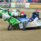 Gisborne's Regan Feck and Martijn Domper (87g) go flying after crashing into the back of James...