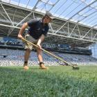 Forsyth Barr Stadium turf manager Michael Watson does some raking on Christmas Day. Photo: Gerard...