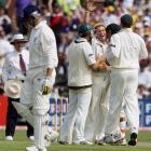 Shane Warne is congratulated by team-mates after taking his 600th test wicket in 2005. Photo:...