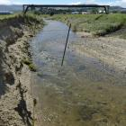 Drinking water supply pipes to Dunedin, including this one crossing the Silverstream, have been '...