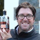 Greg Ramsay, owner of the New Zealand Whisky Co, with a bottle of Dunedin Doublewood 18-year-old,...