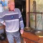 Clyde Museum curator John Hanning looks over the museum's 1862 gold scales and 1866 map of Otago...