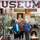 Tokomairiro Historical Society president Nancie Allison (left) and museum volunteers Daune O...
