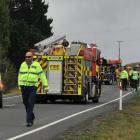 Emergency services at the scene of the crash on New Year's Eve. Photo: Jono Edwards