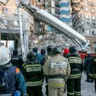 Emergencies Ministry members work at the site of the partially collapsed apartment block in...