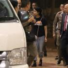Accompanied by UNHCR members and Thai immigration authorities, Rahaf Mohammed al-Qunun leaves...