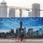 A man cycles outside the construction sites in Beijing's central business area. Photo: Reuters