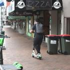 A Lime scooter user in central Dunedin on Thursday morning. Photo: Gregor Richardson