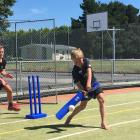 Unleashing a cover drive during the OCCA holiday programme  at Maniototo Area School is Angus...