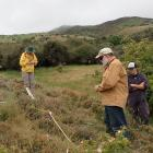 Clyde volunteer Bill Nagle (centre) takes part in a citizen science project near Clyde....