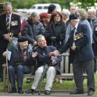 Gordon Weare shakes the hand of RSA member Fred Daniels with former squadron aircrew member...