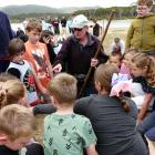 """Papatowai Big Dig organiser Wayne Allen uses his """"magic stick'' to guide youngsters to a prize on..."""