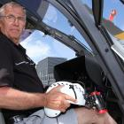 Chief pilot at the Otago Rescue Helicopter Trust Graeme Gale with the Night Vision Goggles he...