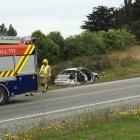 A car at the side of the road after a crash on SH1 near Balclutha. Photo: Richard Davison