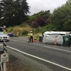A people mover ended up on its side after a crash near Waitati this afternoon. Photo: Gregor...