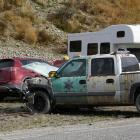 The crash-damaged vehicles in the Stack Conservation Area parking bay after the accident. Photo:...