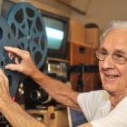 Film restorer Maurice Hayward digitizes old footage at his Opoho workshop. Photo: Christine O'Connor