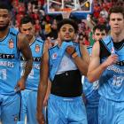 Shawn Long, Corey Webster and Thomas Abercrombie of the Breakers look dejected as they walk off...