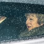 British Prime Minister Theresa May leaves Downing Street to face a vote of no confidence in the...