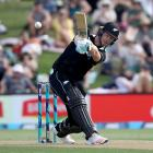 Jimmy Neesham hits out on his way to 47 not out against Sri Lanka. Photo: Getty