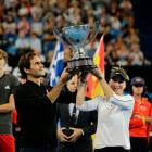 Switzerland's Roger Federer and Belinda Bencic raise the Hopman Cup after defeating Germany's...