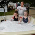 Talia Low (left) and Magic Chirnside (both 14) enjoy a mocktail in Neil George's portable spa...
