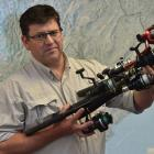 Otago Fish and Game chief executive Ian Hadland holds rods confiscated from unlicensed anglers....