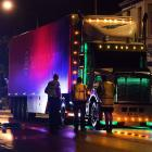 Police talk to a truck driver following an accident involving a truck and a Lime scooter in...
