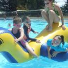Getting amongst the action at the Alexandra Pool Party are (from left) Emma Corson, Addison Gray,...